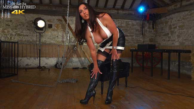 Miss Hybrid leather Sybian ride in thigh boots and stockings.